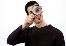 Crazy guy with loupe Royalty Free Stock Photo