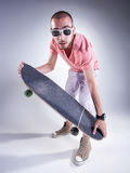 Crazy guy with a skateboard making funny faces Stock Images