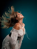 Crazy Hair. Young caucasian woman with hair flying in the air Stock Photography