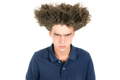 Crazy hair boy. Angry teenage boy with crazy hair isolated in white royalty free stock photos