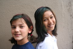 Crazy Hair Day. Two girls with colorful paint in their hair Stock Photo