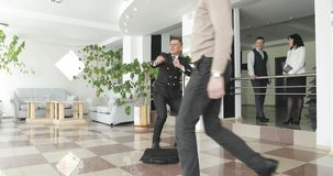 Crazy happy businessman dancing in corporate lobby wearing suit celebrating achievement. stock video