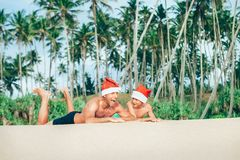 Crazy happy father and son lie on tropical sand beach in Sants h. Ats royalty free stock photo