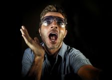 Crazy happy and funny gay guy with sunglasses and modern hipster look taking selfie self portrait picture with mobile phone camera. Smiling cool screaming royalty free stock image