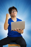 Crazy happy guy with computer laptop Royalty Free Stock Photo