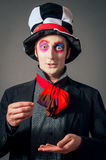 Crazy Hatter. Young man in the image of the Crazy Hatter from Alice's Adventures in Wonderland by Lewis Carroll royalty free stock photography