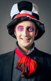 Crazy Hatter. Young man in the image of the Crazy Hatter from Alice's Adventures in Wonderland by Lewis Carroll royalty free stock image