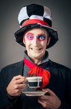 Crazy Hatter. Young man in the image of the Crazy Hatter from Alice's Adventures in Wonderland by Lewis Carroll Royalty Free Stock Photos