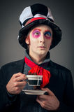 Crazy Hatter. Young man in the image of the Crazy Hatter from Alice's Adventures in Wonderland by Lewis Carroll royalty free stock images