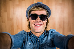 Crazy hipster wearing sunglasses Royalty Free Stock Photo