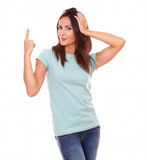 Crazy hispanic female pointing up her finger Royalty Free Stock Photos
