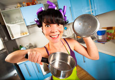 Crazy housewife. In an interior of the kitchen Royalty Free Stock Photo