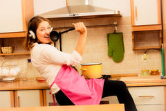 Crazy housewife cook in kitchen Stock Photos