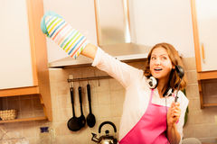 Crazy housewife cook in kitchen Royalty Free Stock Photography