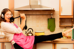 Crazy housewife cook in kitchen Stock Image