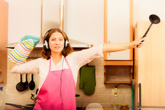 Crazy housewife cook in kitchen Stock Photo
