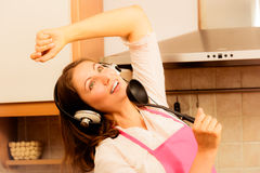 Crazy housewife cook in kitchen Royalty Free Stock Photos