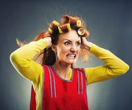 Crazy housewife with curlers Stock Photography