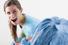Crazy Housewife Fighting With Mop Stock Photo