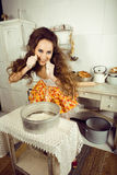 Crazy housewife on kitchen Stock Images