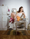 Crazy housewife on kitchen Stock Photos
