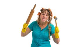 Crazy housewife with kitchen roller and meat hammer Royalty Free Stock Photos