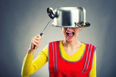 Crazy housewife with sause pan Stock Image