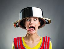Crazy housewife with sause pan on her head Stock Photo