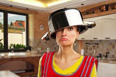 Crazy housewife with sause pan Stock Photo