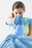 Crazy Housewife With Spray Bottle Stock Photos