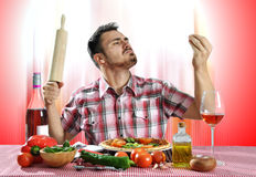 Crazy hungry man eating pizza. In a restaurant Stock Photography