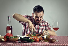 Crazy hungry man eating pizza Stock Photo