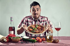 Crazy hungry man eating pizza Stock Image