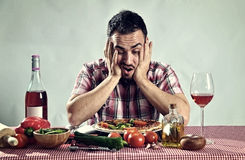 Crazy hungry man eating pizza. In a restaurant Royalty Free Stock Images
