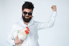 Crazy insane man in with chicken and cigar. Isolated on white background Stock Images