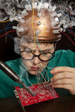 Crazy inventor replacement of electronic components Royalty Free Stock Photo