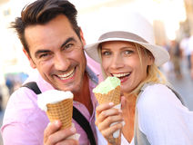 Crazy for Italian ice cream. Cheerful couple in Rome eating ice cream cones Royalty Free Stock Image