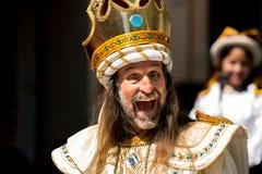 Crazy King. A wild and crazy man in a king costume as a participant in the Pase del Niño parade, Cuenca, Ecuador, December 24, 2013 Royalty Free Stock Image