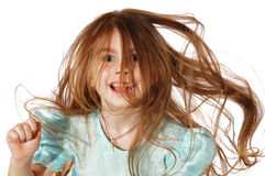 Crazy knock. Little girl with her hair messed and exaltation face expression Stock Image
