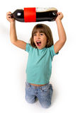 Crazy little female child holding up big cola soda bottle excited and out of control  in children sugar addiction and bad caffeine Stock Photography
