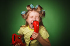 Crazy little girl hosewife screaming into the phone Stock Photos