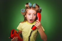 Crazy little girl hosewife screaming into the phone Royalty Free Stock Photos