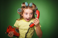 Crazy little girl hosewife screaming into the phone Royalty Free Stock Image