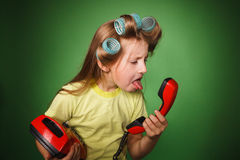 Crazy little girl house wife screaming into the phone stock photo