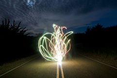 Crazy Long Exposure Sparkler. A bunch of glowing abstract sparkler background image of sparks flying around on the street at night Stock Photography