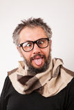 Crazy looking old man with grey beard with nerd big glasses. Show tongue rolling eyes Stock Images