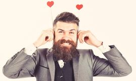 Crazy from love concept. Hipster with beard and smiling face is crazy from love.  royalty free stock photography