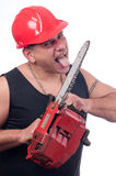 Crazy lumberjack licks blade of electric saw Stock Images