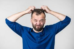 Crazy mad adult man. Furious bearded adult man, guy acting crazy being mad having mental crisis stock images