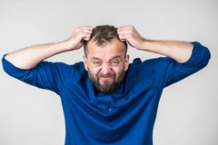 Crazy mad adult man. Furious bearded adult man, guy acting crazy being mad having mental crisis stock photos